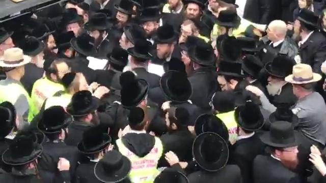 As snow swirled, the body of Rebbe Mordechai Hager was taken out of the yeshiva in a crush of mourners, and placed in a Toyota minivan on Friday, March 16, 2018.