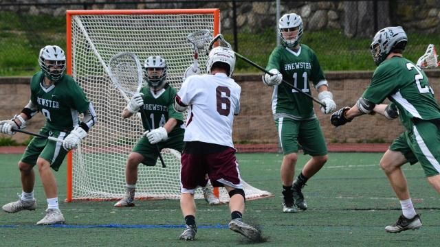 Brewster only got one hour of practice in ahead of a 15-4 playoff win over Ossining due to damage left by a storm earlier in the week. Video by Mike Dougherty/lohud.com