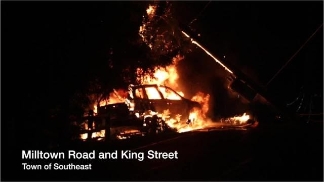 An early morning crash and fire shut Milltown Rd in Southeast July 17, 2018. Putnam Lake firefighters extinguished the blaze, the driver was uninjured.