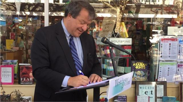 Westchester County Executive George Latimer signs a bill into law requiring sick days for most workers in the county.
