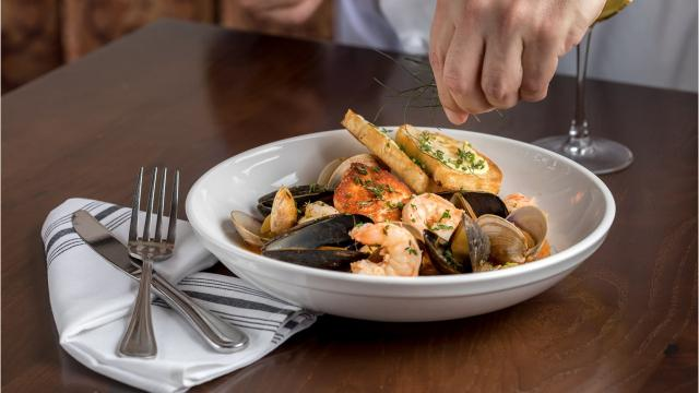The restaurant now serves French classics on the corner of Battery Park Avenue and Haywood Street.