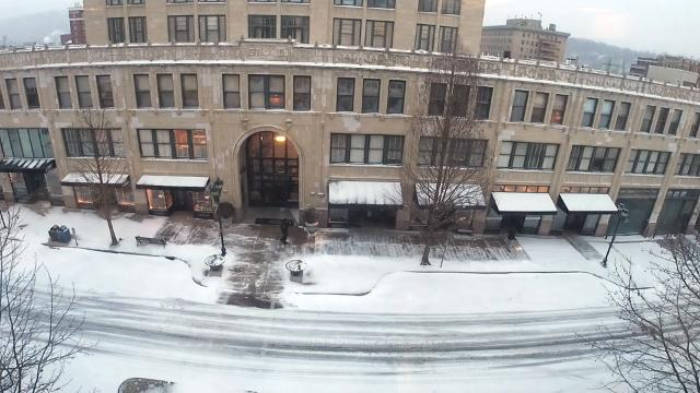 Watch as a sidewalk is cleared of snow at the Grove Arcade January 17, 2018.