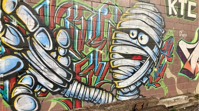 A reader wants to know who owns the graffiti walls in the River Arts District and how you can paint there.