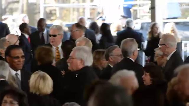 Funeralgoers arrive to pay their respects to the Rev. Billy Graham.