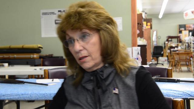 Debra Jackson, owner of Fruitful Seasons Pistol Packing gun store in Hendersonville, and Jane Bilello, a retired teacher, both advocates of arming school teachers, talk about gun rights and gun violence.