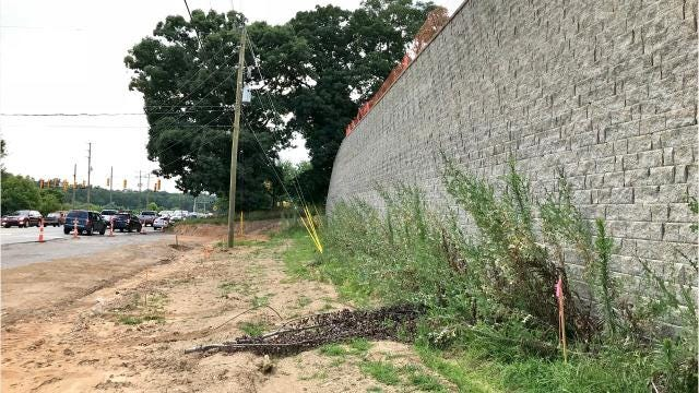 Massive retaining wall on Mills Gap Road to stay? Trees coming down?