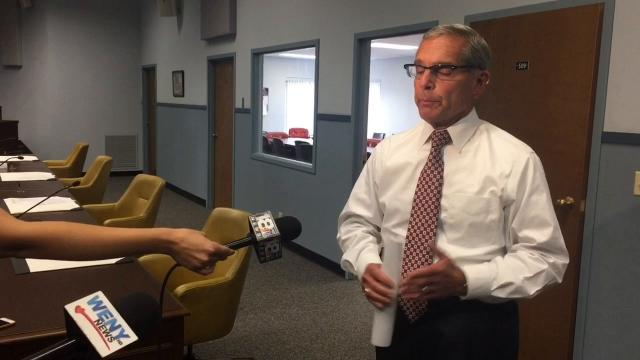 Chemung County Executive Tom Santulli addresses the media July 14 following a meeting of the county Industrial Development Agency's board of directors.