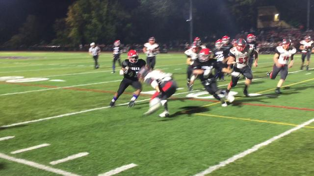 Jeremiah Allen of Chenango Forks picks up some yards, then gets a lift.