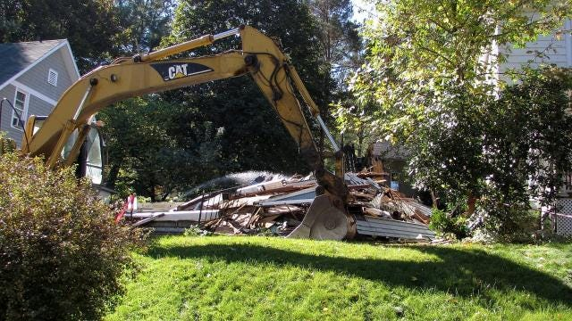 A home damaged by an arson fire in 2008 was finally demolished Monday.