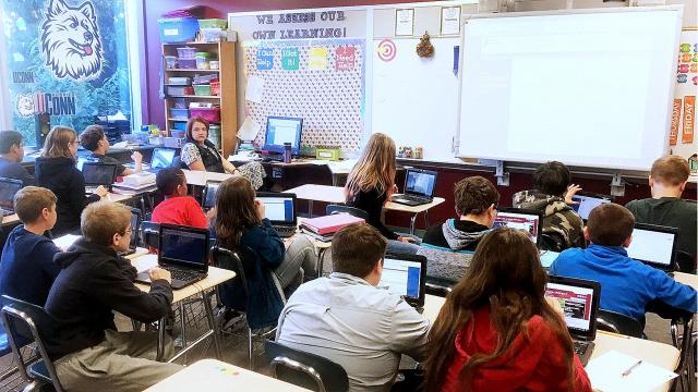 New hybrid laptop/tablet computing devices will help students at Broadway Academy learn about technology.