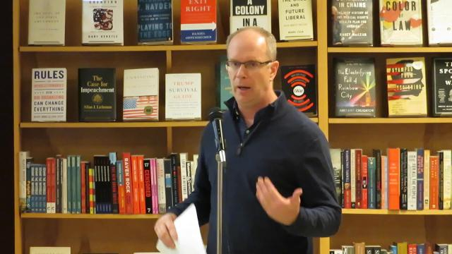 Rob Vanderlan, board president of Buffalo Street Books, tells owners of the community-owned bookstore the challenges the business is facing.