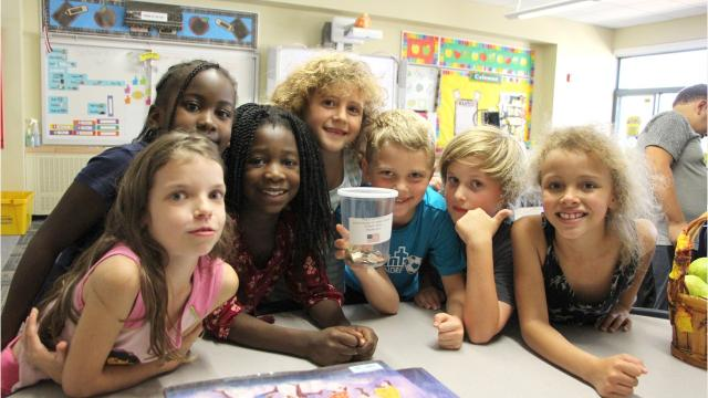 Students from McArthur Elementary School raised $1,762 for victims of Hurricane Harvey.