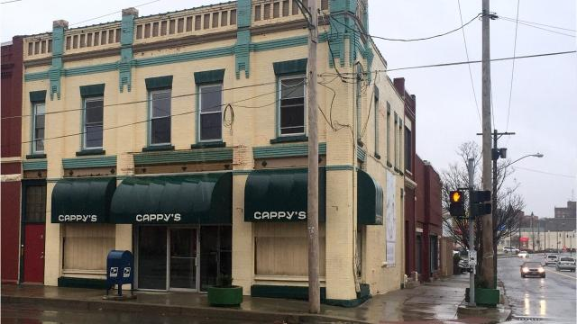 The building that housed Cappy's, a once-popular card and gift shop, is being demolished to make room for green space.