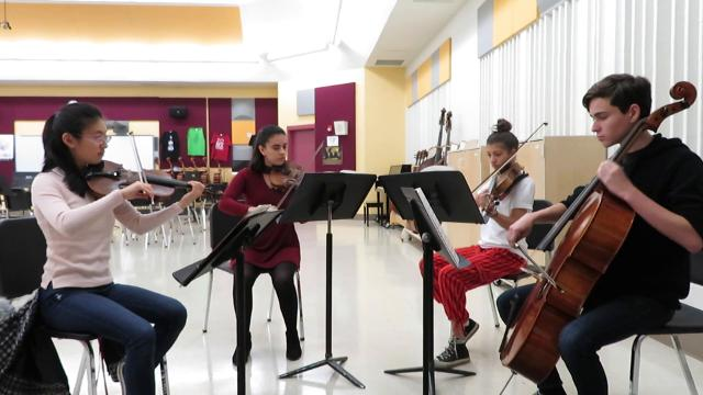 "A string quartet from Ithaca High School plays a part of Johann Strauss II's ""The Blue Danube Waltz."""