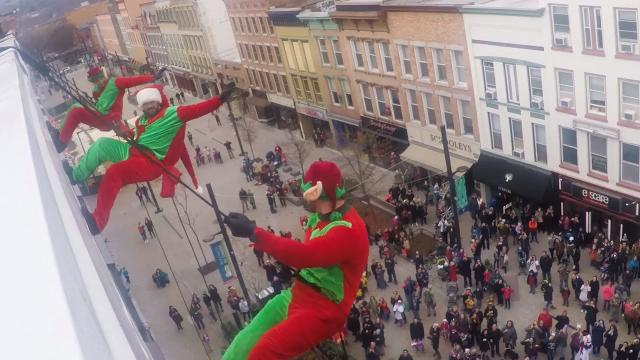 An annual holiday tradition, Santa and the Ithaca Police Department SWAT team rappeled from atop Center Ithaca on Saturday, Dec. 3, 2017.