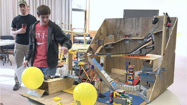 Engineering students at Corning Community College showed off machines they designed to perform a simple task with a series of complicated steps.