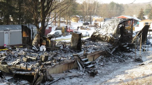 A trailer home fire killed two people and destroyed a home in Newfield.