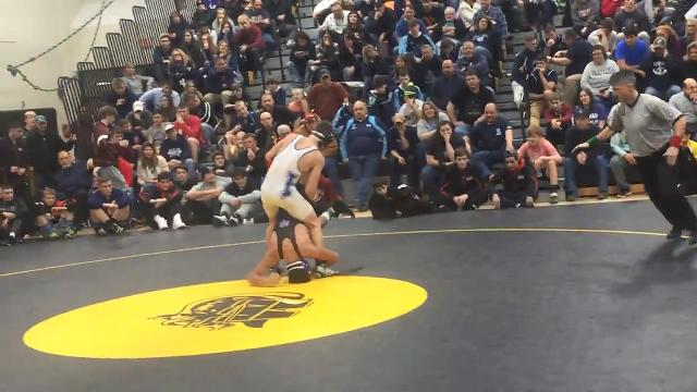 Norwich's Eli Rodriguez wrestles Horseheads' Jacob Scibek in the Windsor Christmas Tournament's 132-pound title match Friday. Rodriguez's 5-1 victory helped the Purple Tornado win the team title.