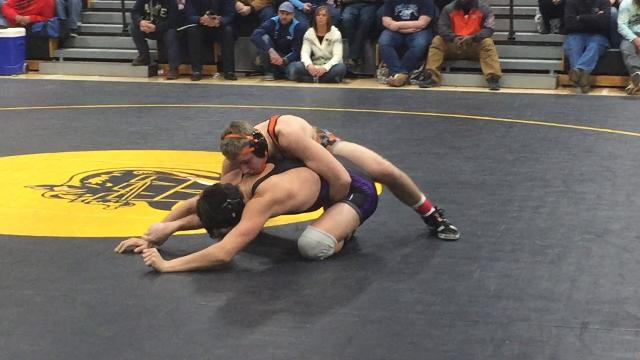Norwich's Ty Rifanburg and Phoenix's Ross McFarland wrestle in the Windsor Christmas Tournament's 170-pound final.