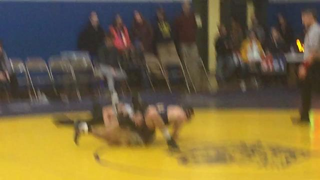 Tioga's Austin Lamb pins Norwich's Austyn Hatton during Thursday's Section 4 Division II Dual Meet championship match at Tioga. The host Tigers lost the match, 38-30.