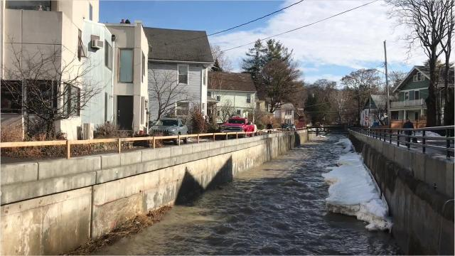 Warm temperatures, rain and ice jams caused high, swift waters on Cascadilla Creek in Ithaca.