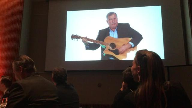 Paul Brenner, Incoming Chair of Tompkins County Chamber of Commerce, serenades guests at the chamber's 2018 annual dinner and awards at Ithaca College.