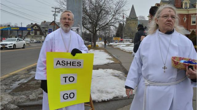 On Wednesday, local deacons stood in front of Redeemer Lutheran in Binghamton provide ashes to people who passed by.