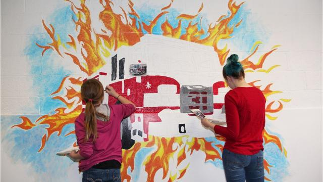 VIDEO: M-E students create mural for firemen