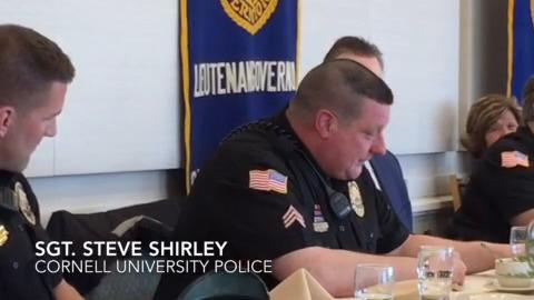 Sgt. Steven Shirley, of the Cornell University Police Department, was recognized as the Officer of the Month by the Kiwanis Club of Ithaca-Cayuga. He and other officers speak during a recognition luncheon.