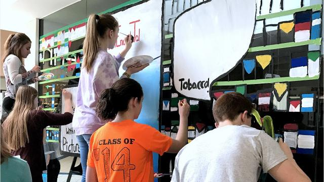 Teens from the Southern Tier Tobacco Awareness Coalition Reality Check program create an anti-tobacco mural at the Arnot Mall.