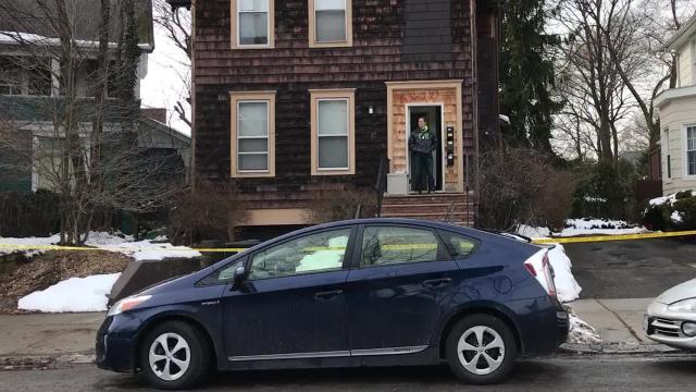 Law enforcement officials investigate crime scene at 23 Oak St. in Binghamton.