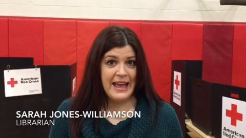 Sarah Jones-Williamson, a South Hill Elementary School librarian affected by a rare bone marrow disorder, gives a heartfelt thanks to people who donated at a blood and bone marrow drive at the school.