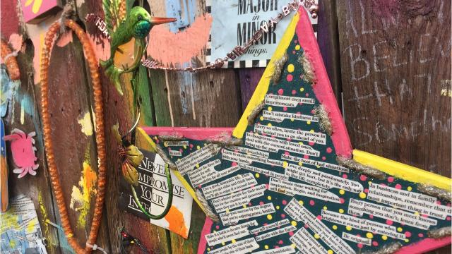 Video: In her own words, artist explains up-cycled fence mural