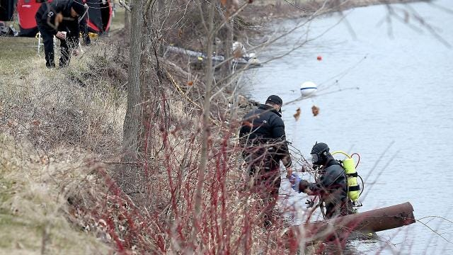 Law enforcement officials, including the New York State Police, FBI and Ithaca Police Department, search Cayuga Inlet on April 12, 2018.
