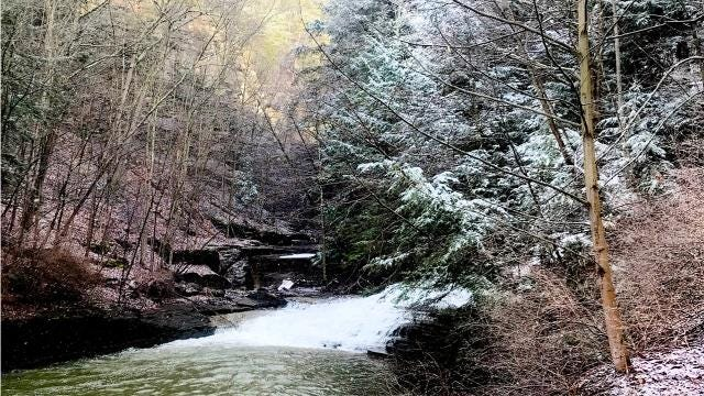 Spring storms brought a wintery mix of snow, rain and sleet to the Finger Lakes recently, causing Ithaca's famous gorges and waterfalls to fill with cold, rushing water.