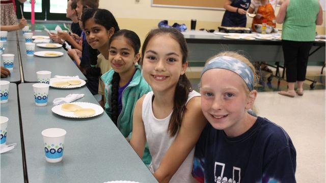 For 14 years, Vestal Hills Elementary School teachers, faculty and staff have been whipping up pancakes to celebrate the last day of school.