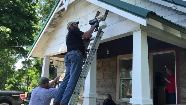 Volunteers from Corning Inc. refurbish the Disabled American Veterans headquarters in Elmira Heights as part of the United Way Day of Action.