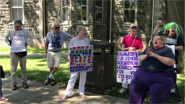 Protesters chant against U.S. Rep. Tom Reed, an administration supporter, during a rally against U.S. immigration policies Saturday in Elmira.