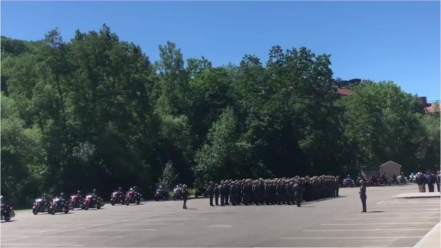 New York State Police motorcycles lead Trooper Clark funeral procession.