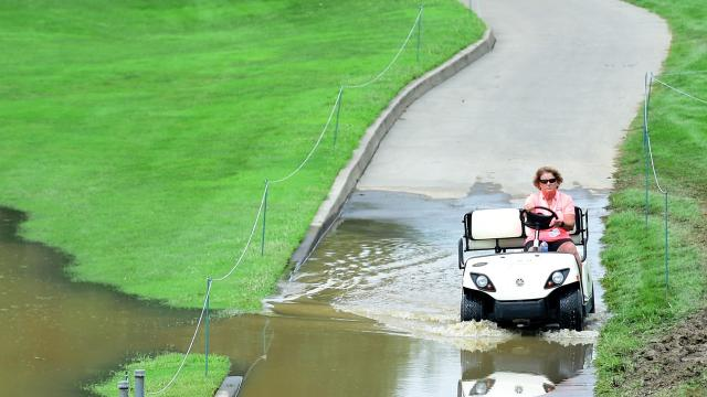 Heavy rain left several En-Joie greens underwater as PGA golfers took to the course on Wednesday, but grounds crews worked furiously to pump out the water.