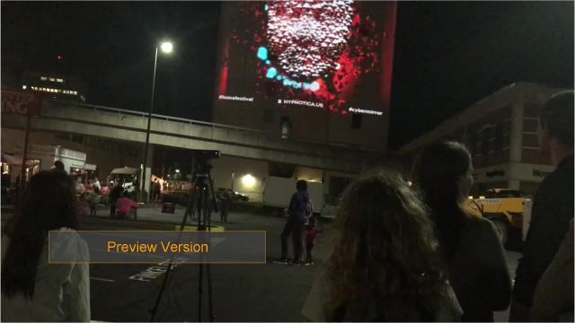 """Created by Hypnotica, """"Cyber Mirror"""" used the face of participants to manipulate a large projection on the side of 59 Court Street."""