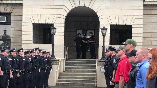 The Elmira Police Department held a walkout ceremony Friday for retiring police officer Jeremy Oakes.