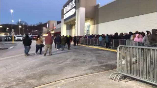 Shoppers waiting in line for Black Friday deals on Thanksgiving.