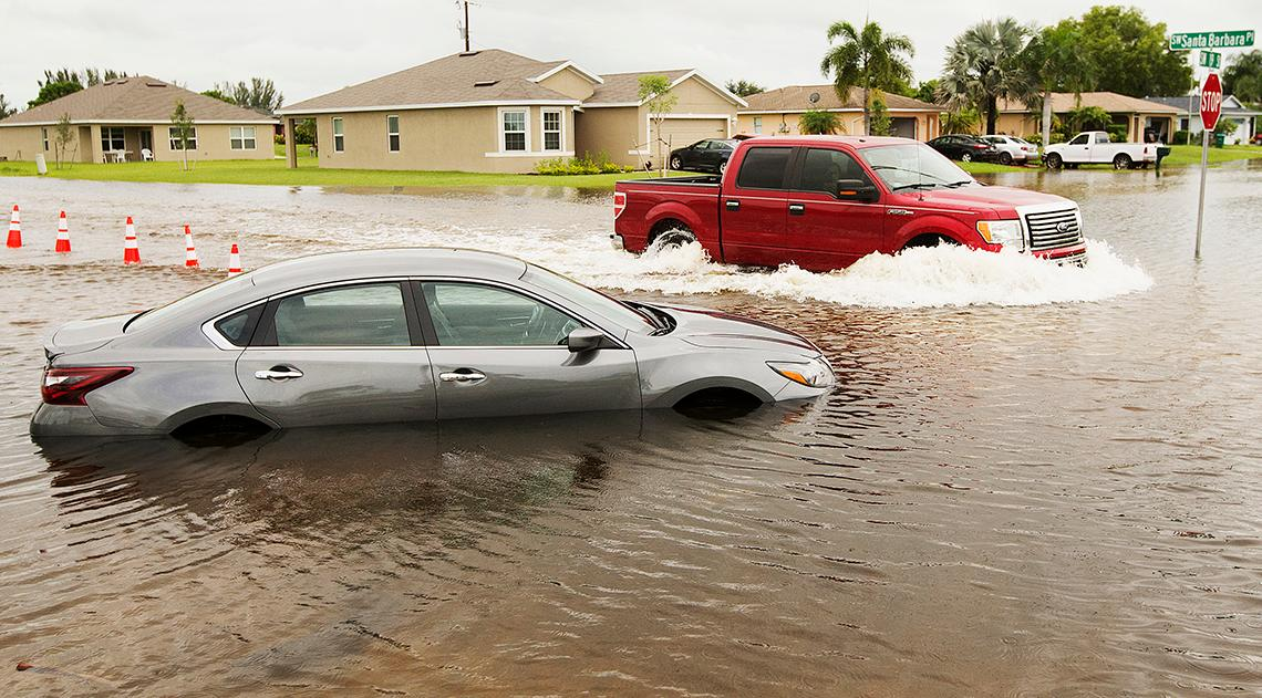 Heavy rains flood cars and streets in Cape Coral and SWFL.