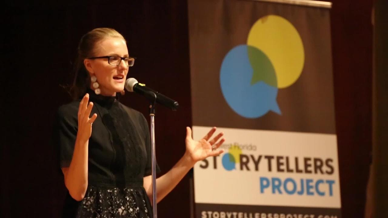 Journalist Janine Zeitlin shares a memorable story from her career during the inaugural Southwest Florida Storytellers Project at the Cape Coral Yacht Club.