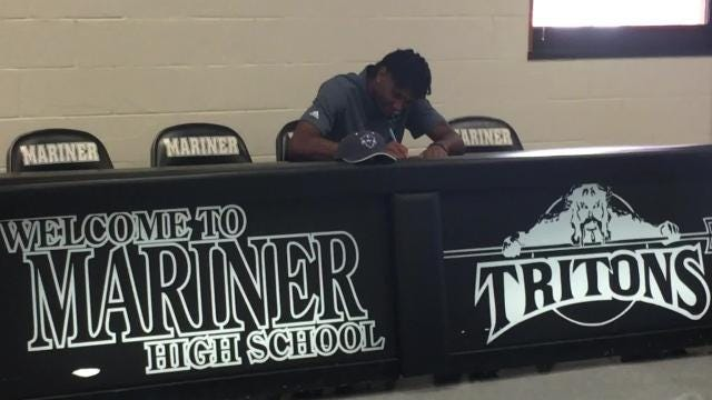 Mariner's Jahmel Myers signs a basketball scholarship with New Orleans
