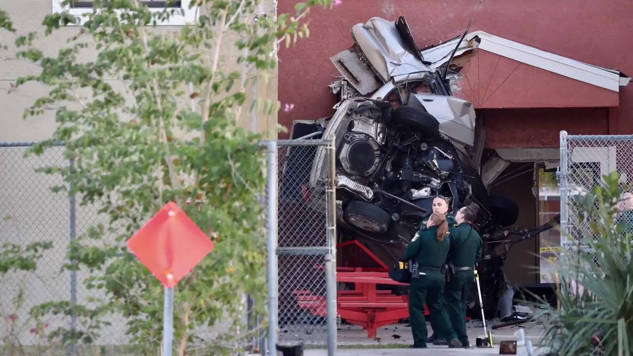Parents, students and teachers watched as a man sped into the back side of Evangelical Christian School on Wednesday, January 17, 2018, in Fort Myers. He was killed in the crash, and school has been canceled Thursday because of damage to the school.