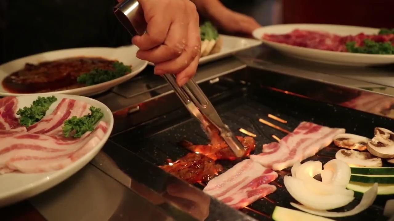 Rosa Kim, the owner of Origami in south Fort Myers, shows how they cook Korean barbecue at the restaurant.