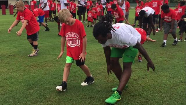 More than a dozen of Lee County's best high school and college football players gave lessons to younger kids at the VL Sports Foundation's first free football camp Saturday, May 26, 2018, at the North Fort Myers Recreation Center.