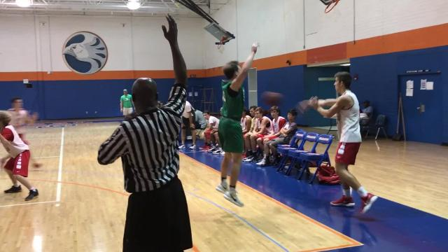 A last-second 3-pointer by ECS's Chase Goodwin gives Sentinels 59-56 win in title game over Fort Myers.